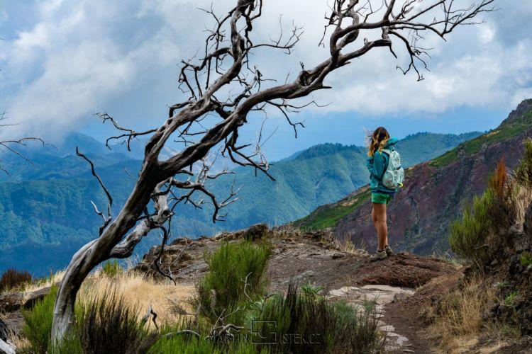 Woman traveler at Madeira mountain hiking path.