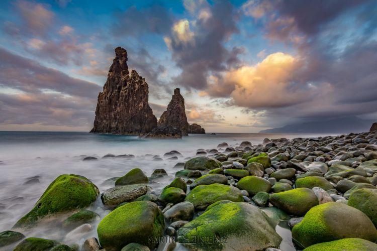 Sunset over rocky coast.